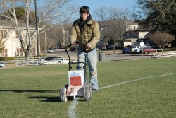 Adam Rodriguez lines the Robert K. Moses, Jr. playing field with the new system in preparation for a women's lacrosse ma...