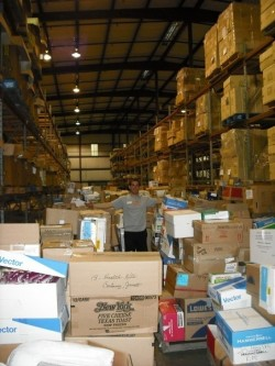 Ted  Wilson stands among boxes of relief supplies at UMCOR headquarters in Baldwin, La.
