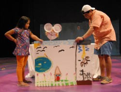 "Gabe Chaves works with students on a puppet show version of ""Little Bo Peep."""