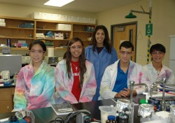 Chemistry Professor Maha Zewail-Foote stands with some of the students participating in the STEP program this summer. (Pho...