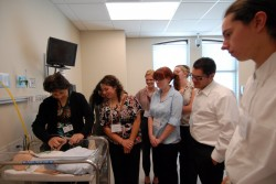 Nancy Ruiz gives first-year students a tour of the Simulation Center at the Texas A&M Health Science Center in Round R...
