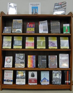 The library has a display featuring books by speakers who will be at the Sept. 10 symposium.