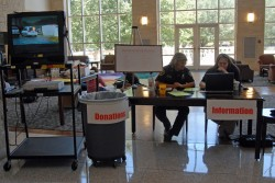 Deborah Brown and Anne Hines from the SU Police Department staff a table in the Campus Center where students can get infor...