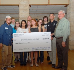 Students in Melissa Byrnes' First-Year Seminar on philanthropy present a check to representatives from the Boys