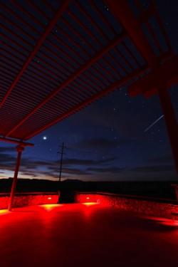 David Leggett captured this image of a shooting star (at right) at  the Marfa Lights Viewing Station.
