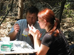 Andy Glusenkamp from the Texas Parks & Wildlife Department trains Southwestern student Ashley Wall on how to mark the ...