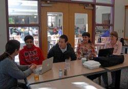 Chinese Professor Patricia Schiaffini (left) meets with students Le'Loni Brown, Lawrence Li and Daisy Mateus to discuss ...