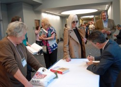 Wayne Pacelle, president and chief executive officer of the Humane Society of the United States, signs copies of his book,...
