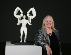 Mary Visser stands with one of her sculptures that was included in an exhibition that traveled around China in conjunction...