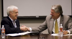 Southwestern University President Jake B. Schrum shakes hands with Stephen B. Kinslow, ACC district president/CEO, after s...