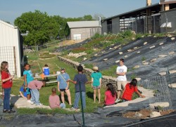 Students from the Boys & Girls Club of Georgetown visit Southwestern's Community Garden March 30.
