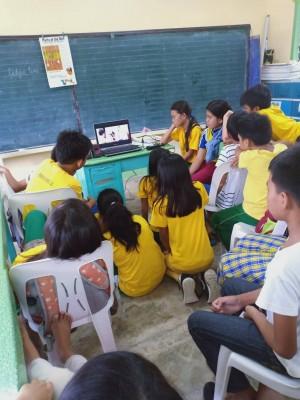 Elementary students in Miagao interact with their new technology.
