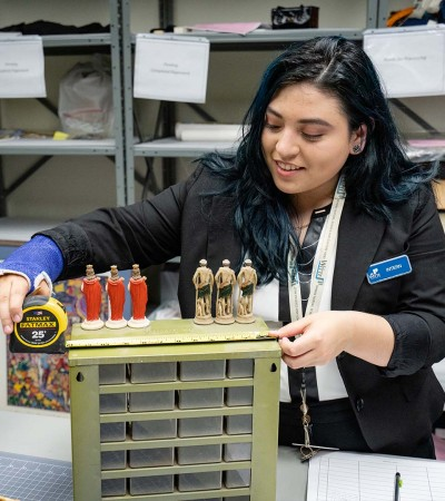 Art history major Paola Bazan '22 interned with the Witte Museum cataloging a botanica collec...