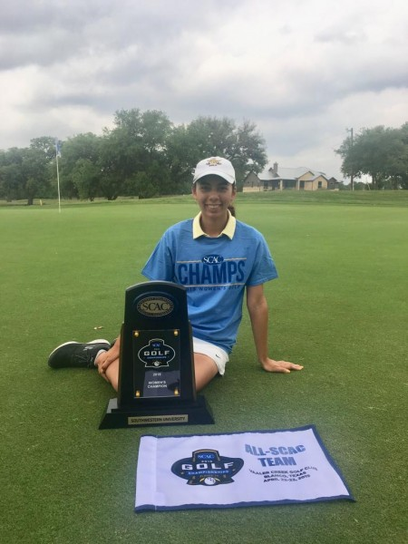 Valentina Olivieri-Puentes '19 with the SCAC Women's Golf Championship trophy.