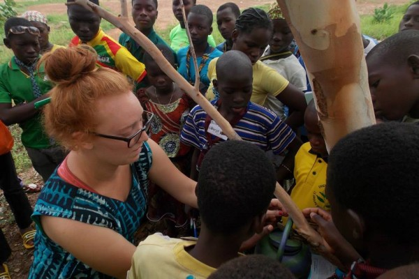 Carlie Sulpizio '13 with community members of Burkina Faso, Africa.