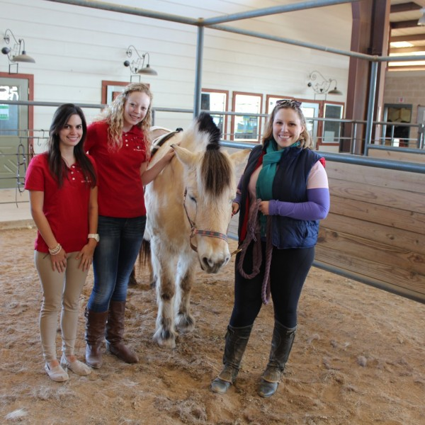 Celia Caraccioli (left) and Meredith Rollins stand with Emilie Ross (right), an applied behavior analyst who works at R.O.C.K., and Shandy, one of the ponies the center uses to provide equine-assisted therapy to children. (Photo by Elizabeth Stewart)