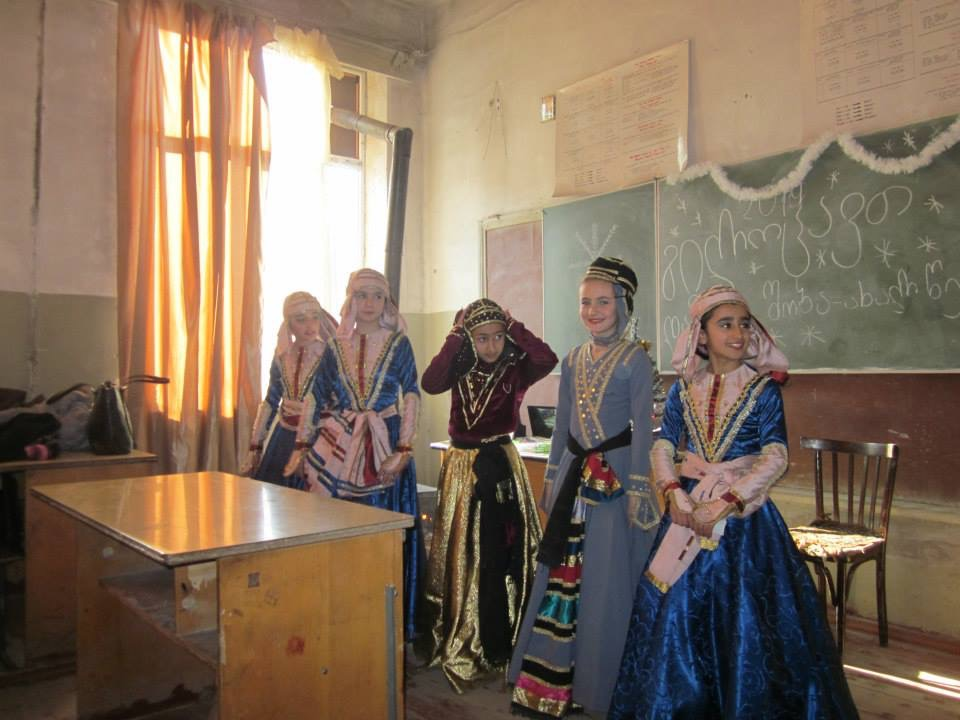 Some of Ellermann's students wearing traditional Georgian dress and performing traditional Georgi...