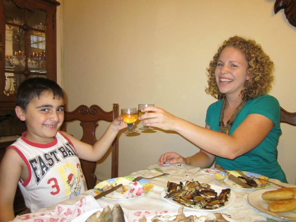 Ellermann toasting her host cousin, Besiki, at a Supra (a feast) her host family prepared for Ell...