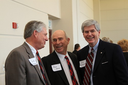 President Jake Schrum '68 with Mike Weir and Ken Klaveness '69.