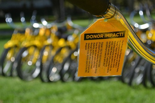 """Donor Impact"" tags were placed all over campus, including on all the Pirate Bikes, to highlight the significanc..."