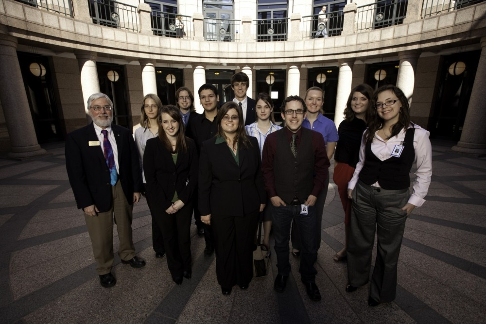Political Science Professor Tim O'Neill stands in the State Capitol with participants in this year's Texas Politics Intern...