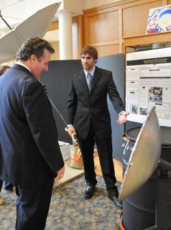 Eric Godat presenting his project to Joey King.